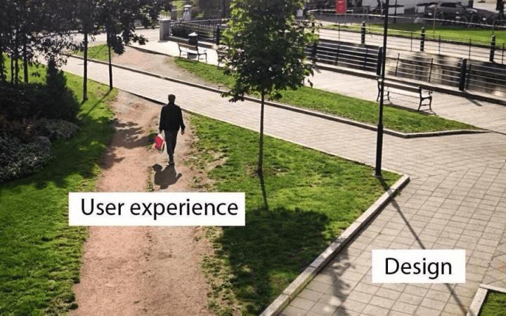 Homem caminhando pelo canteiro de terra (User experience) enquanto há um caminho pavimentado (Design) ao lado